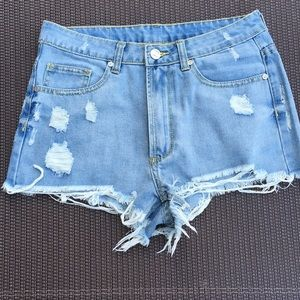 UNIF distressed shorts. Size 25.
